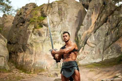 spartan on the background of rocky mountains, warrior, fighter h
